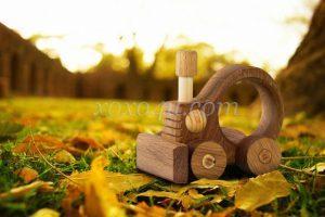 игрушка каталка Тракторенок