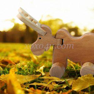 игрушка каталка лосенок