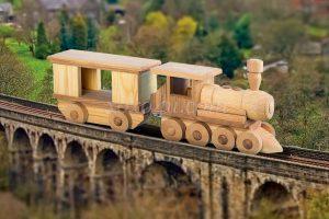 игрушка поезд с  вагоном
