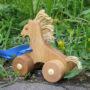 деревянная игрушка каталка лошадка